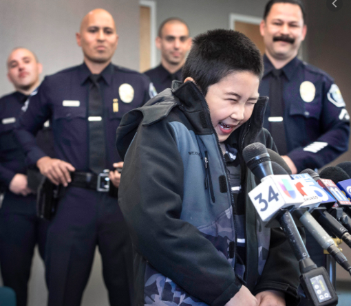 Police in awe as a kid entertains them in California. (Credit: Google)